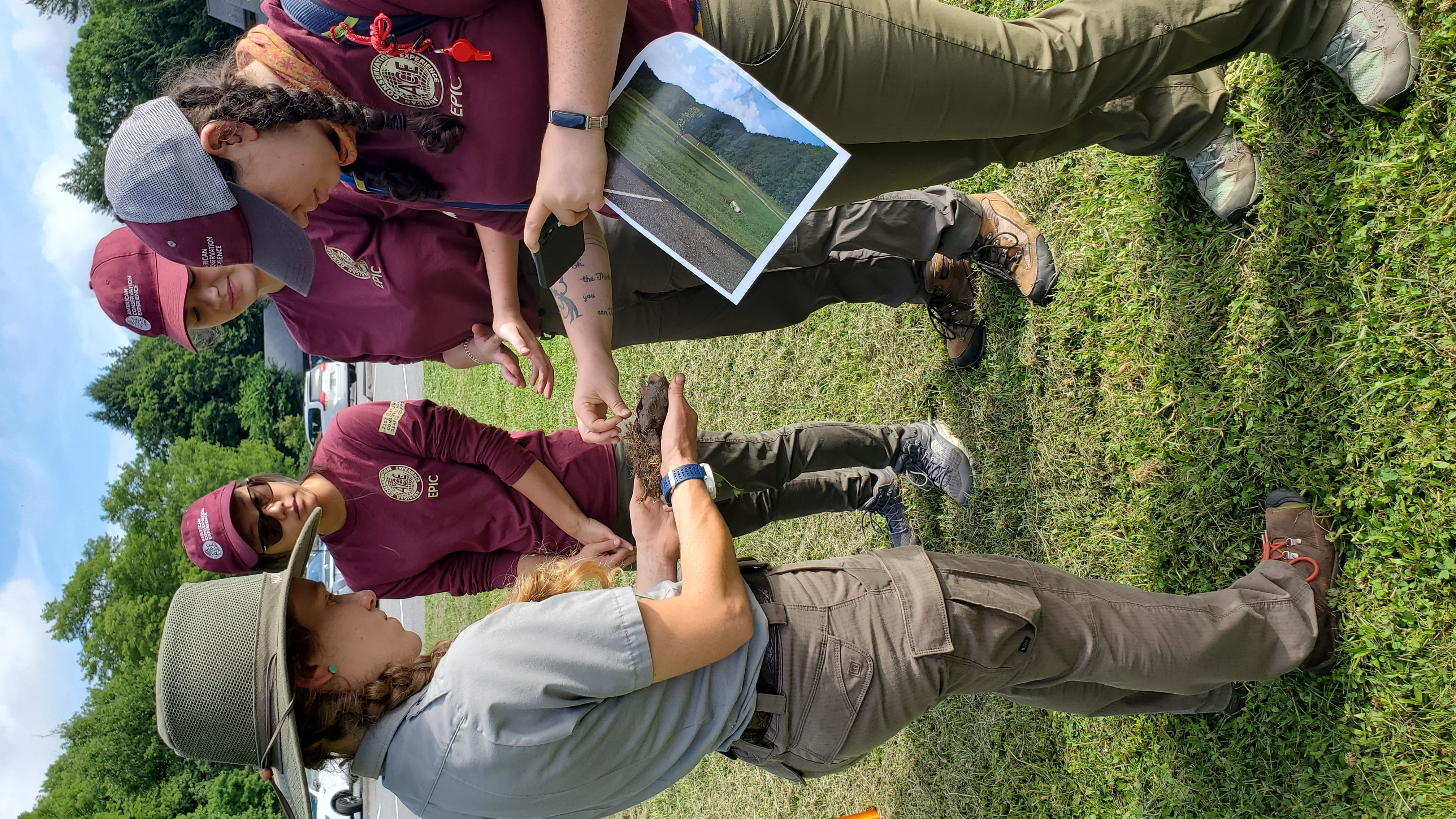 NPS biological science technician Alix Pfennigwerth shows a soil specimen from a local wetland to interns Stella Walborn, Phoebe Carnes, and Chelsea Tharp. Courtesy NPS.