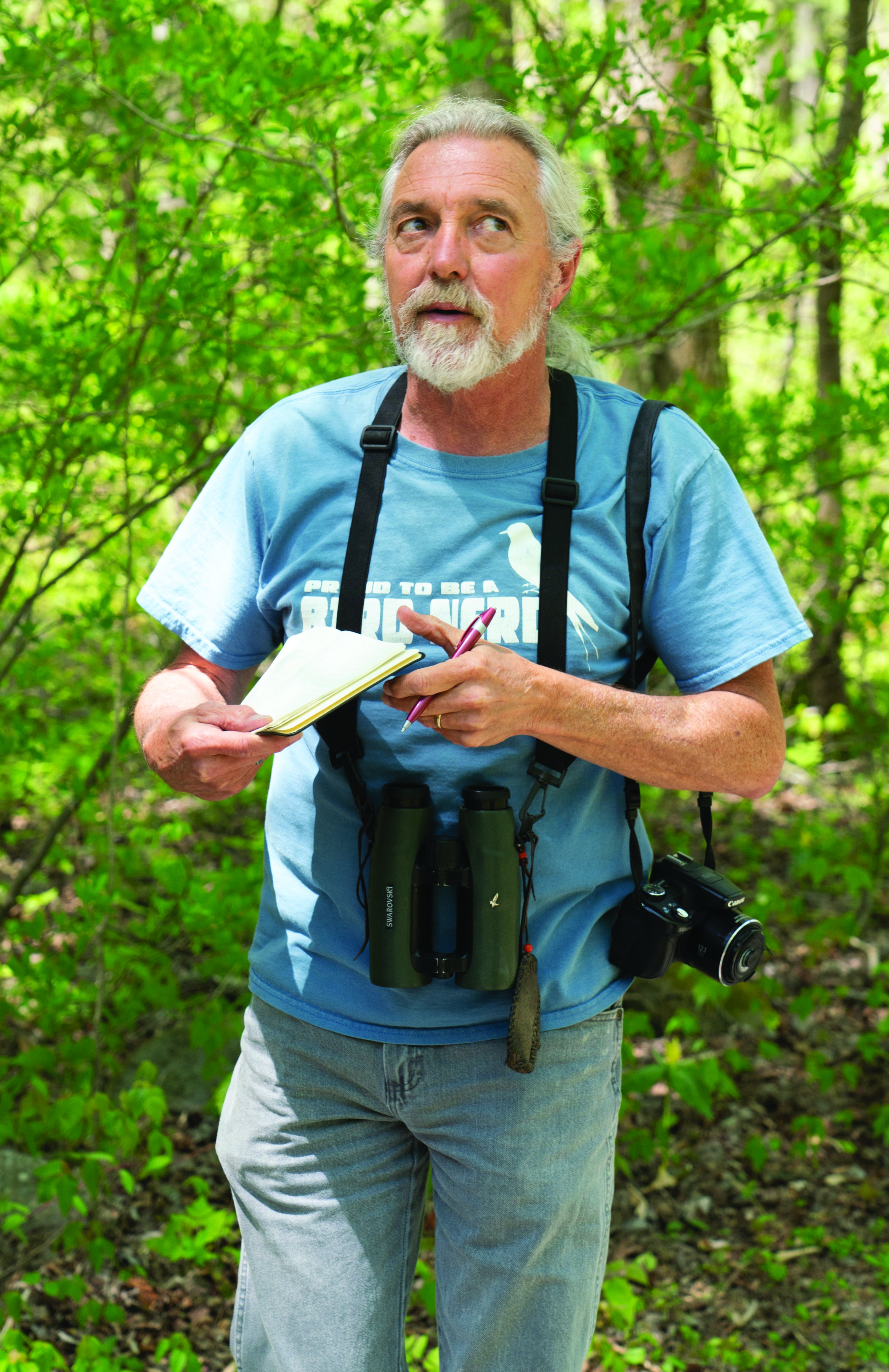 Keith Watson, a professional birding guide and former biologist with the National Park Service, pauses to listen for birdsong in Great Smoky Mountains National Park. Photo courtesy of Joye Ardyn Durham.