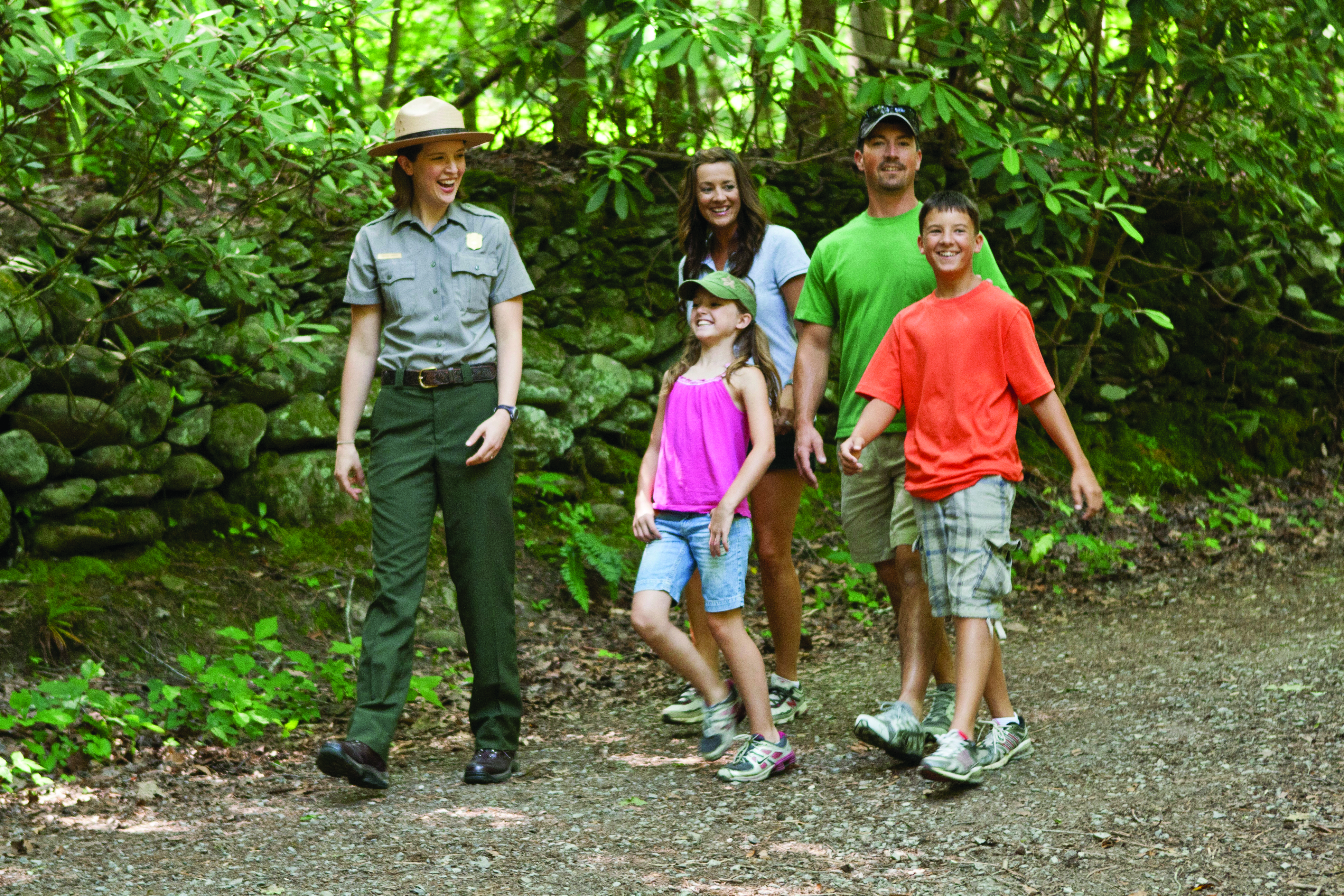Ranger Caitlin Worth, acting management assistant at Great Smoky Mountains National Park, answers visitor questions and helps them plan their activities. Photo courtesy of NPS.