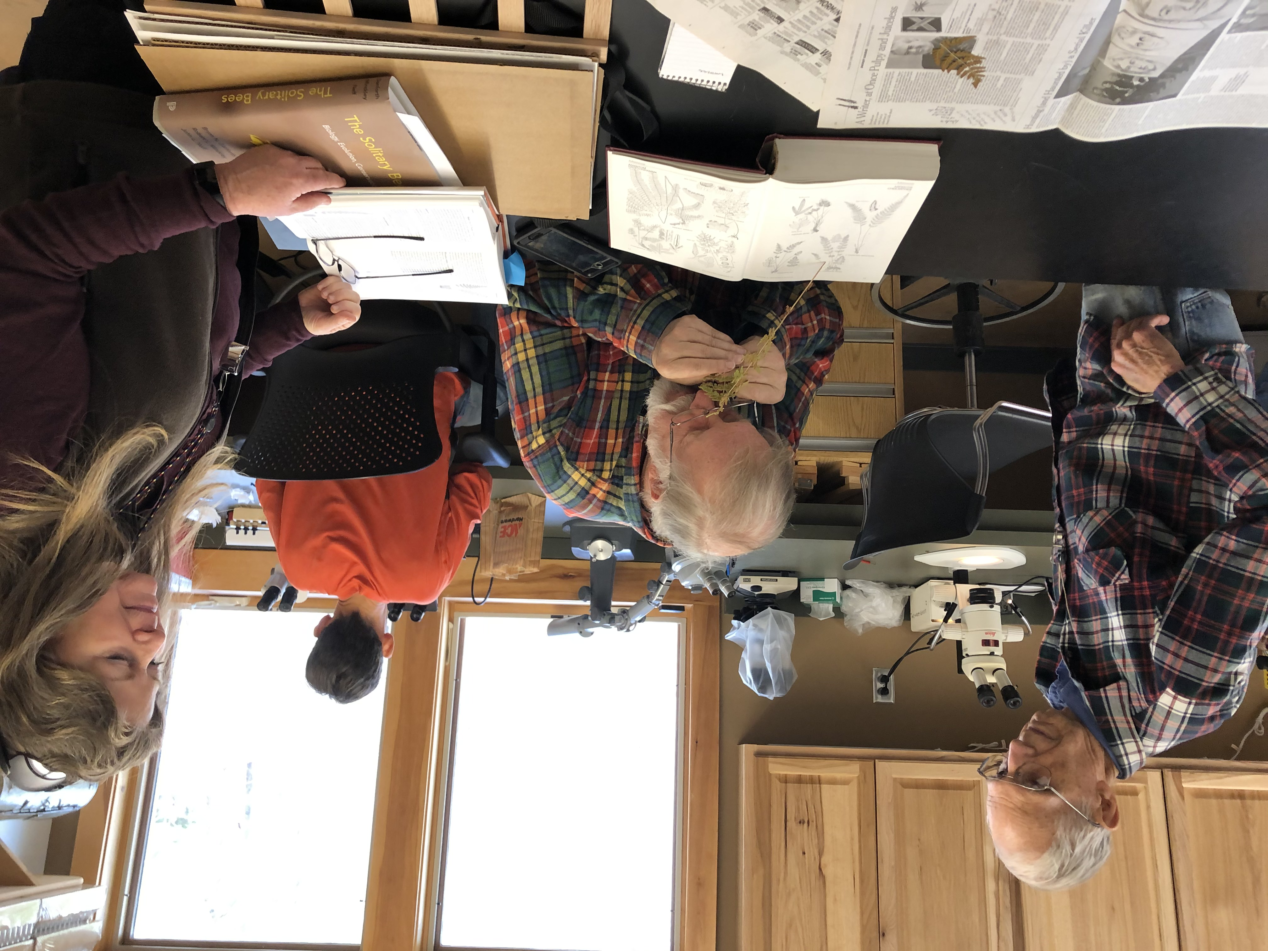 Dan Pittillo looks on as Keith Langdon investigates specimens for their work with the Gang of Researchers in Search of Life's Diversity (GRISLD).