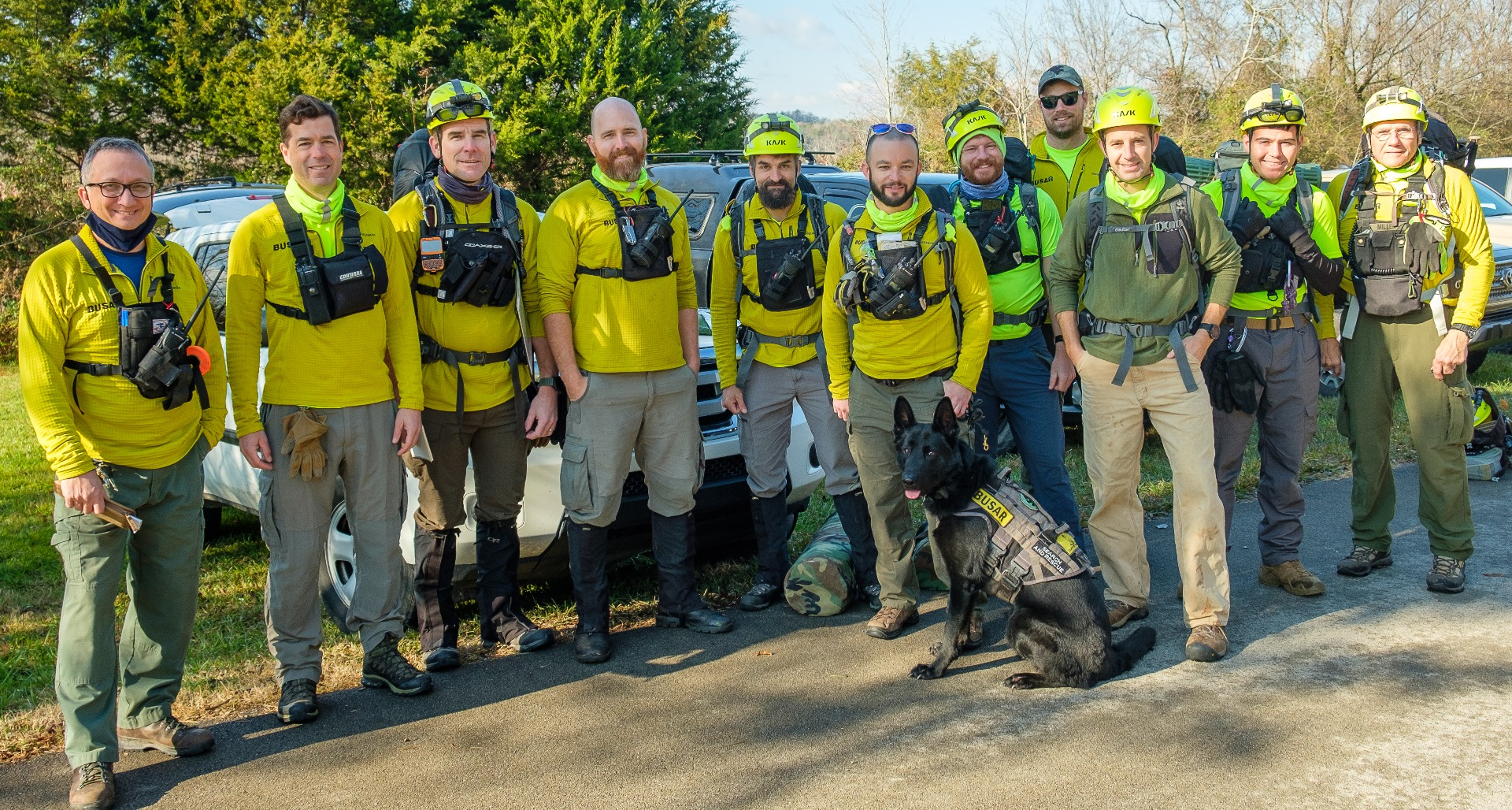 Team BUSAR group photo of eleven men and one German Shepard dog