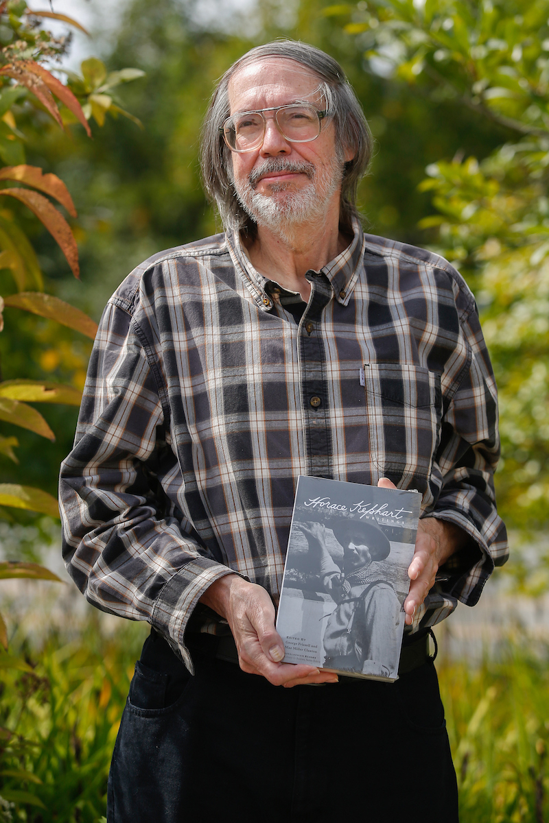 George Fizzle holding a copy of his new book Writings