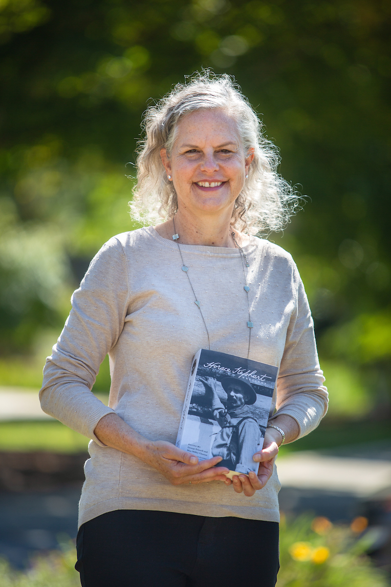 May Claxton holding a copy of her new book Writings